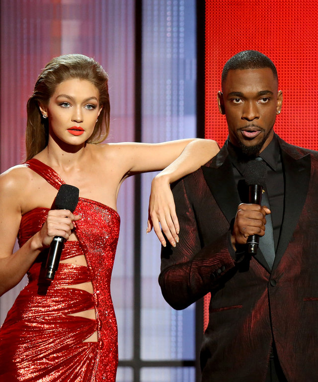 Hosts Gigi Hadid (L) and Jay Pharoah speak onstage during the 2016 American Music Awards held at Microsoft Theater on November 20, 2016 in Los Angeles, California.
