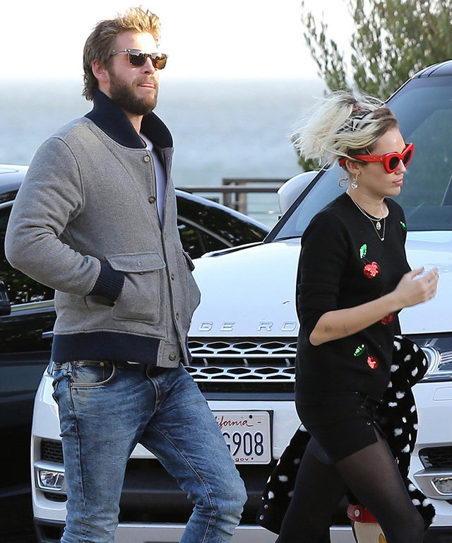 Miley Cyrus Rocks a Cherry-Covered Sweater for Date Night with Liam Hemsworth