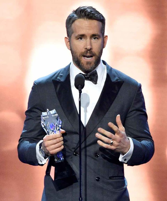 Ryan Reynolds accepts the EW entertainer of the year award at the 22nd annual Critics' Choice Awards at the Barker Hangar on Sunday, Dec. 11, 2016, in Santa Monica, Calif. (Photo by Chris Pizzello/Invision/AP)
