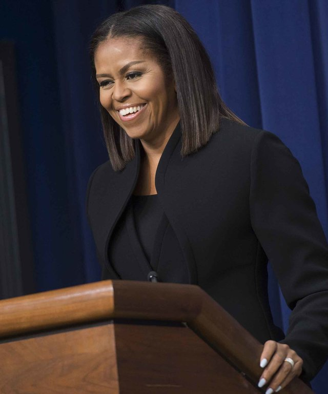 US First Lady Michelle Obama speaks following a screening of the movie,  Hidden Figures,  in the Eisenhower Executive Office Building adjacent to the White House in Washington, DC, December 15, 2016. / AFP / SAUL LOEB        (Photo credit should read SAUL