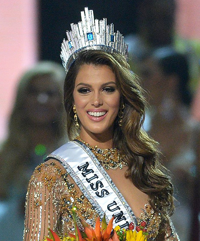 Iris Mittenaere of France walks on stage after being crowned the winner of the Miss Universe pageant at the Mall of Asia Arena in Manila on January 30, 2017. France was crowed Miss Universe on January 30 in a glitzy spectacle free of last year's dramatic