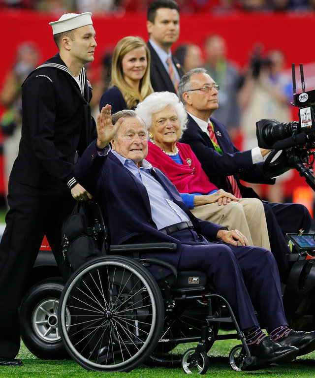 President George H.W. Bush and Barbara Bush look on during the coin toss prior to Super Bowl 51 between the Atlanta Falcons and the New England Patriots at NRG Stadium on February 5, 2017 in Houston, Texas.