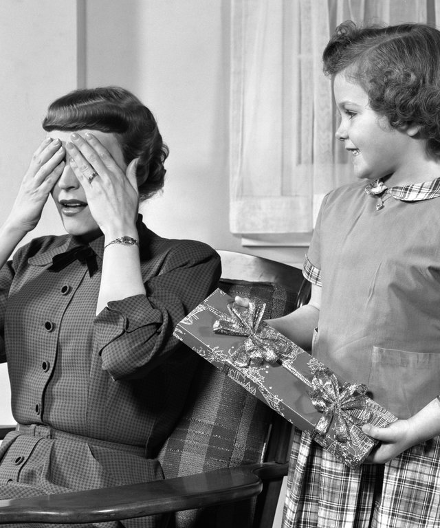 1950s WOMAN MOTHER HANDS...