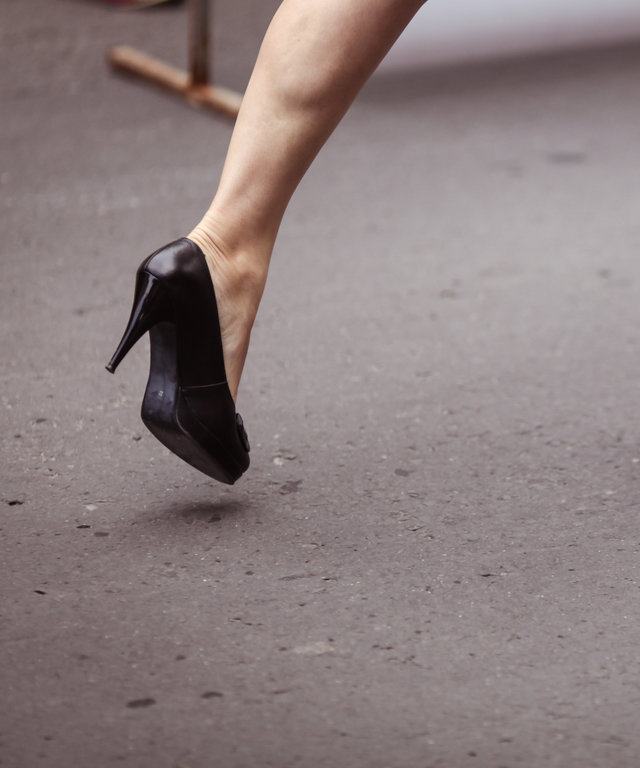 Woman running on high heels