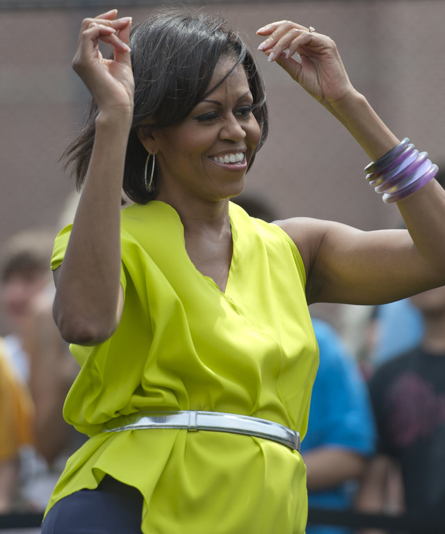 Surprise First Lady Michelle Obama greets the students and teachers of Alice Deal Middle School in Tenleytown, with a suprise visit, where she and the students and teachers participated in the 'Let's Move! Flash Workout.'                         A pre-choreographed dance routine