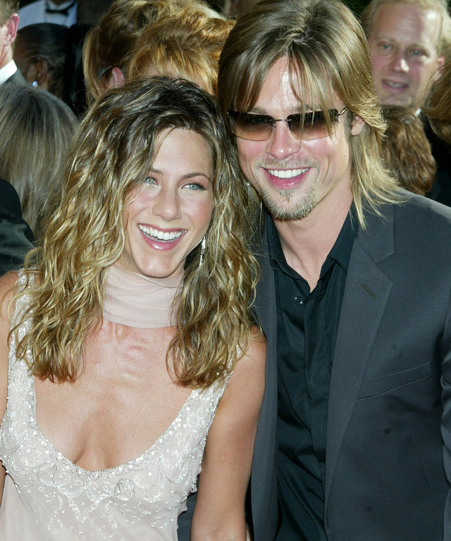 Jennifer Aniston and Brad Pitt arriving at the Shrine Auditorium in Los Angeles for the 54th Annual Primetime EMMY Awards 09/22/02
