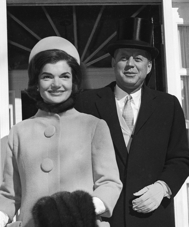 John Kennedy and Jacqueline Leaving For White House
