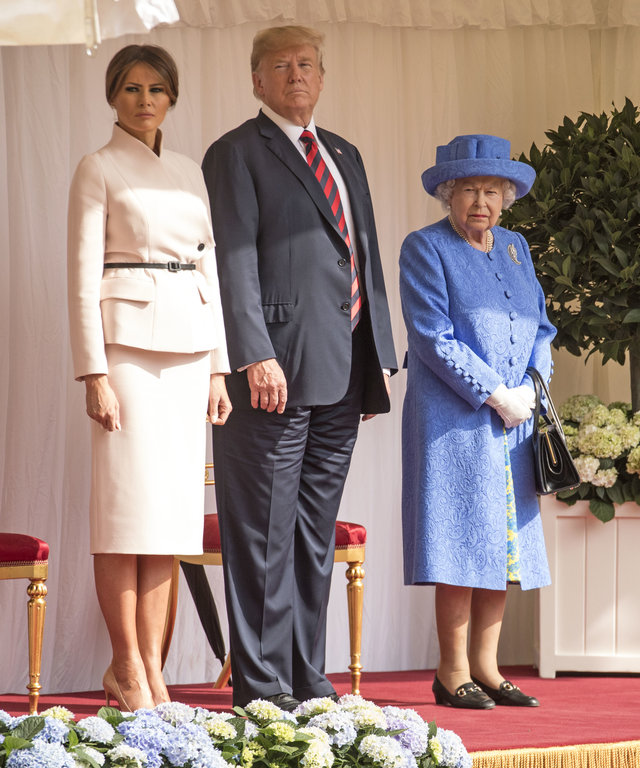 WINDSOR, ENGLAND - JULY 13:  U.S. President Donald Trump and first lady Melania Trump stand with Britain's Queen Elizabeth II on the dais in the Quadrangle of Windsor Castle on July 13, 2018 in Windsor, England.  Her Majesty welcomed the President and...