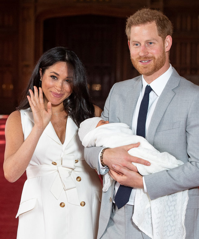 Britain's Prince Harry, Duke of Sussex (R), and his wife Meghan, Duchess of Sussex, pose for a photo with their newborn baby son, Archie Harrison Mountbatten-Windsor, in St George's Hall at Windsor Castle in Windsor, west of London on May 8, 2019. ...