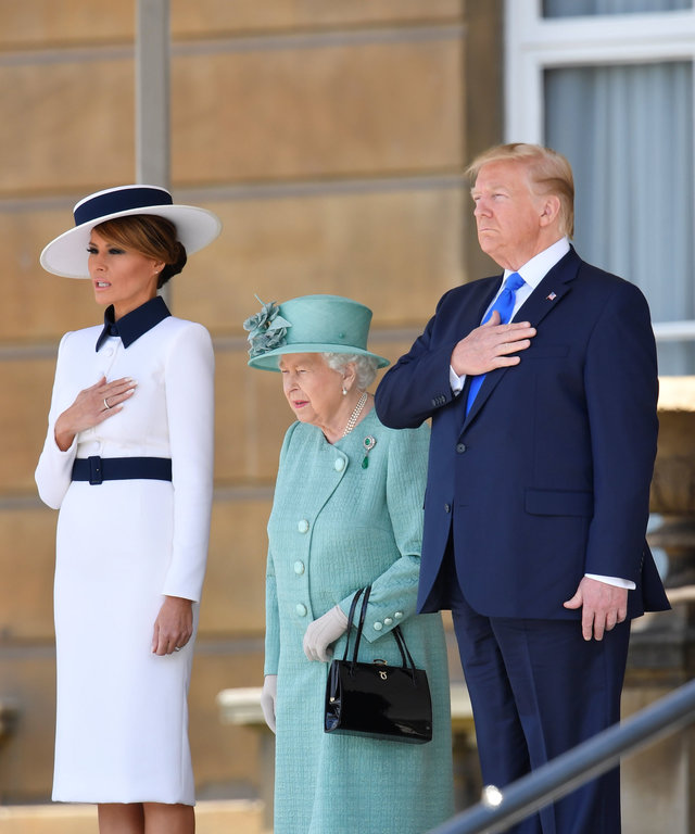 LONDON, ENGLAND - JUNE 03:  Queen Elizabeth II stands with US President Donald Trump and US First Lady Melania Trump as they listen to the US national anthem during a welcome ceremony at Buckingham Palace on June 3, 2019 in London, England. President...