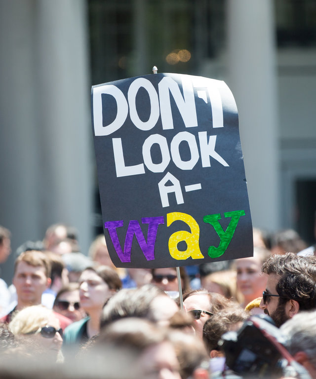 BOSTON, MA - JUNE 26:  A participant of the Wayfair walkout holds a sign tha reads  Dont Look Away  in Copley Square on June 26, 2019 in Boston, Massachusetts. Wayfair sold more than $200,000 in bedroom furniture to a Texas detention facility for...
