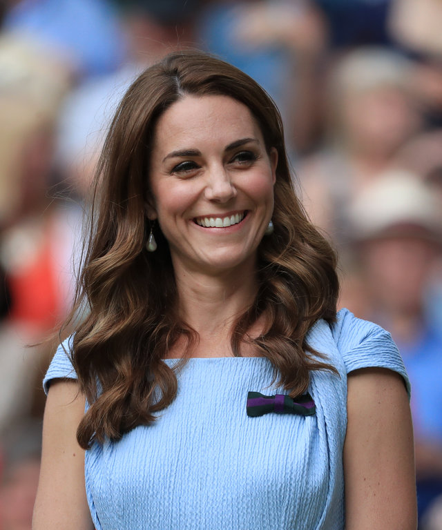 LONDON, ENGLAND - JULY 14: Catherine, Duchess of Cambridge laughs and smiles on Day 13 of The Championships - Wimbledon 2019 at the All England Lawn Tennis and Croquet Club on July 14, 2019 in London, England. (Photo by Simon Stacpoole/Offside/Getty...