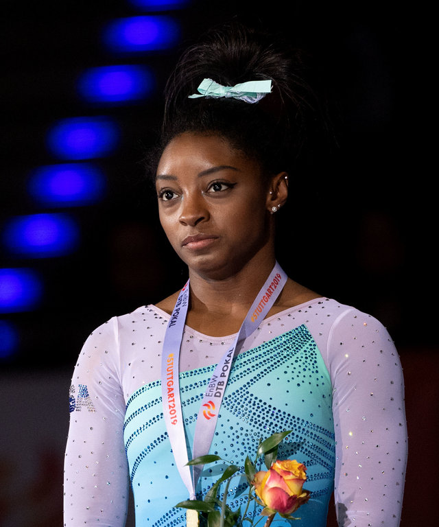 17 March 2019, Baden-Wuerttemberg, Stuttgart: Gymnastics, World Cup: all-around, women in the Porsche Arena: Simone Biles from the USA at the award ceremony. Photo: Marijan Murat/dpa (Photo by Marijan Murat/picture alliance via Getty Images)
