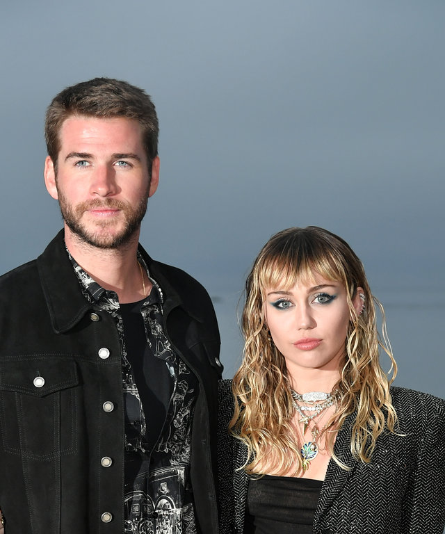 MALIBU, CALIFORNIA - JUNE 06: (L-R) Liam Hemsworth and Miley Cyrus attend the Saint Laurent Mens Spring Summer 20 Show Photo Call on June 06, 2019 in Malibu, California. (Photo by Neilson Barnard/Getty Images)