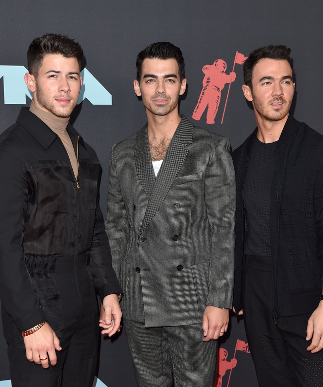 NEWARK, NEW JERSEY - AUGUST 26: Nick Jonas, Joe Jonas, and Kevin Jonas attend the 2019 MTV Video Music Awards at Prudential Center on August 26, 2019 in Newark, New Jersey. (Photo by Axelle/Bauer-Griffin/WireImage)