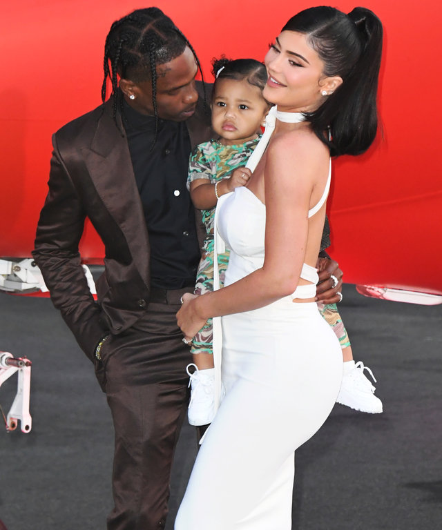 SANTA MONICA, CALIFORNIA - AUGUST 27:  Travis Scott, Stormi Webster and Kylie Jenner attend the Premiere Of Netflix's  Travis Scott: Look Mom I Can Fly  at Barker Hangar on August 27, 2019 in Santa Monica, California. (Photo by Jon Kopaloff/FilmMagic)