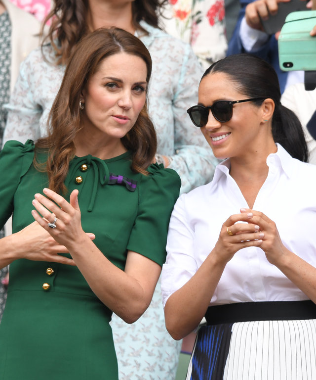 LONDON, ENGLAND - JULY 13: Catherine, Duchess of Cambridge and Meghan, Duchess of Sussex in the Royal Box on Centre Court during day twelve of the Wimbledon Tennis Championships at All England Lawn Tennis and Croquet Club on July 13, 2019 in London,...