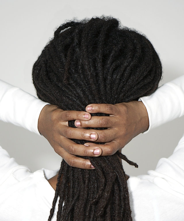 Woman holding her hair