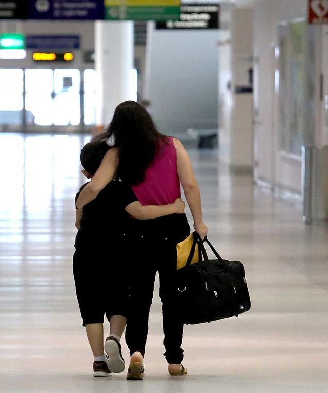 How to Use Your Airline Miles to Reunite Immigrant and Refugee Families - Lead