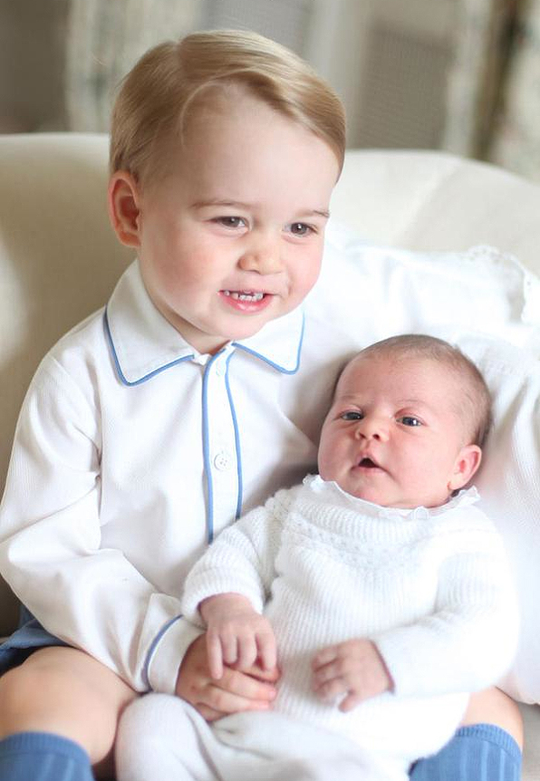 <p>Princess Charlotte Is Held By Prince George</p>