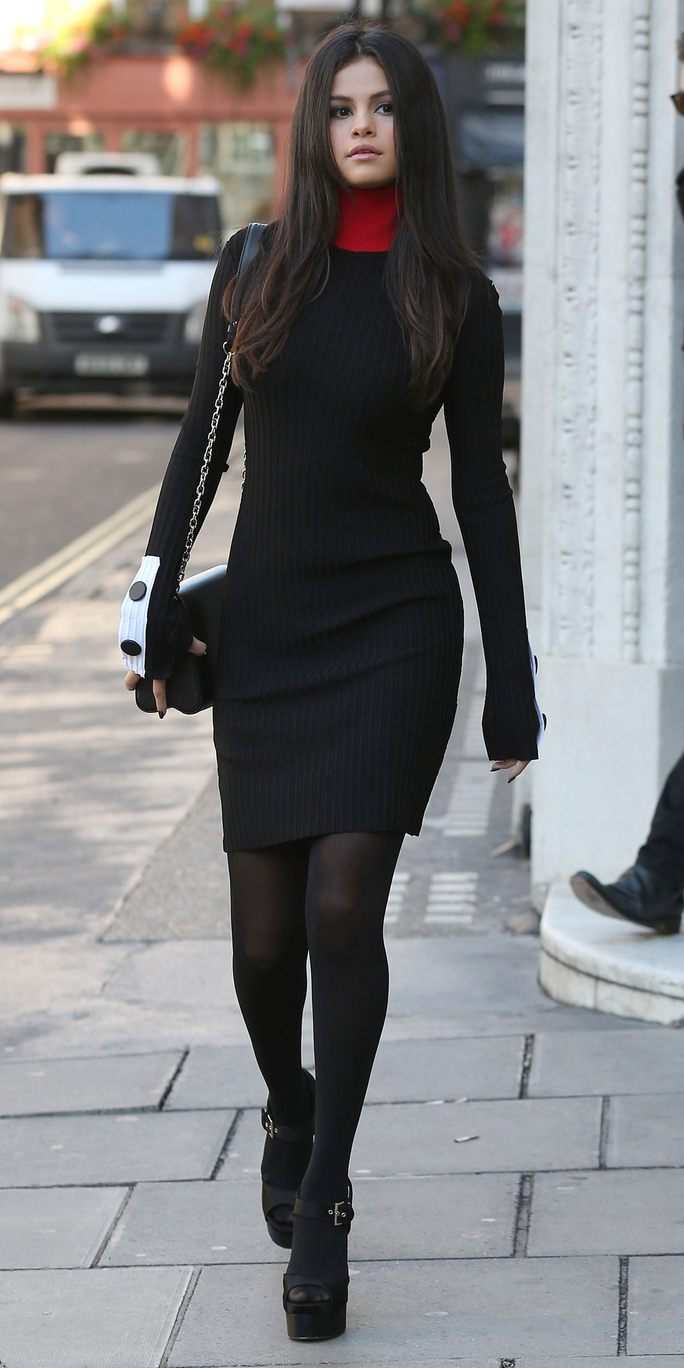 <p>In a Ribbed Knit Dress</p>