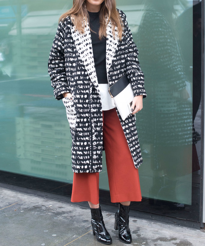 LONDON, ENGLAND - SEPTEMBER 22: Fashion blogger Philippa Bloom wears an H and M coat, Zara top and trousers, Iris and Ink at The Outnet bag and Kurt Geiger boots on day 5 during London Fashion Week Spring/Summer 2016/17 on September 22, 2015 in London, En