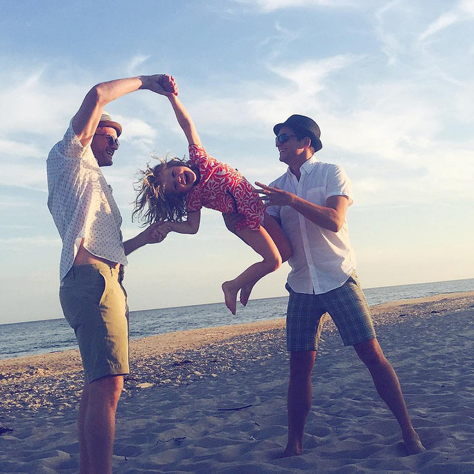 <p>Harper Enjoys the Beach with Her Dads</p>