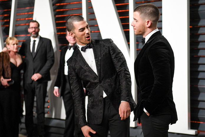 Mandatory Credit: Photo by Billy Farrell/BFA/REX/Shutterstock (8436435fc)                               Joe Jonas, Nick Jonas                               Vanity Fair Oscar Party, Los Angeles, USA - 26 Feb 2017