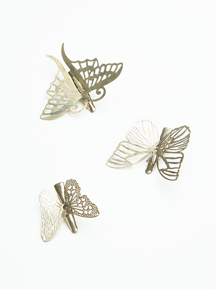 <p>GOLD BUTTERFLY CLIPS</p>