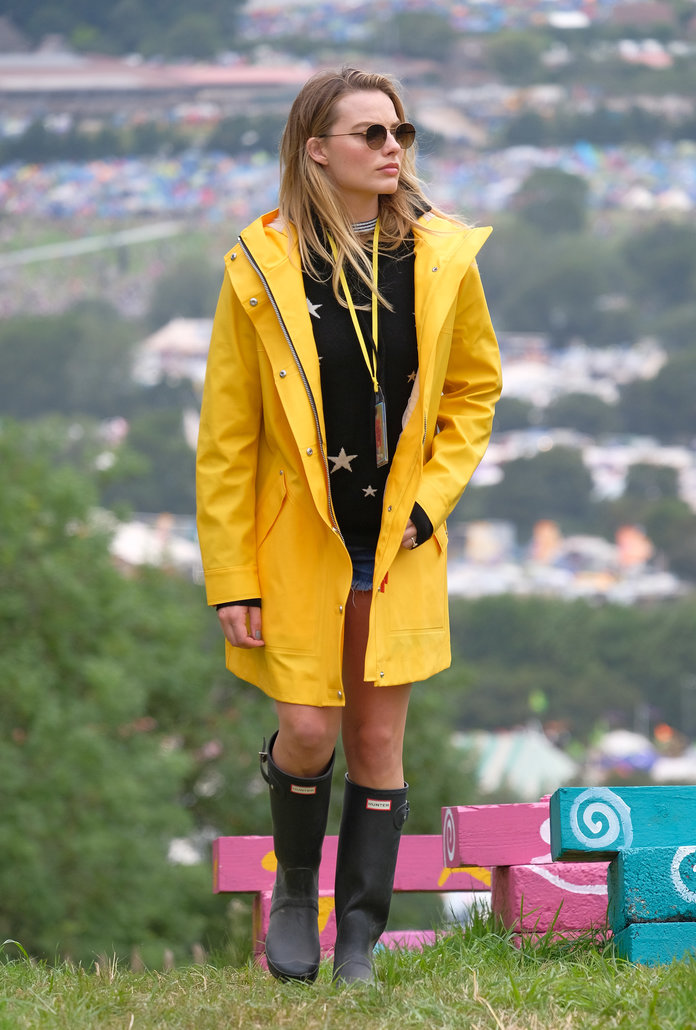 <p>Margot doing fisherman chic in Hunter Originals boots and coat</p>
