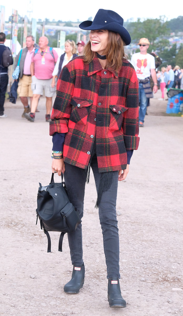 <p>Alexa Chung lassoes a western look together for Glastonbury with Hunter Originals backpack and boots.</p>
