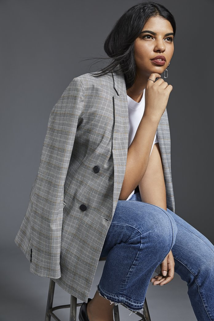 model in plaid blazer
