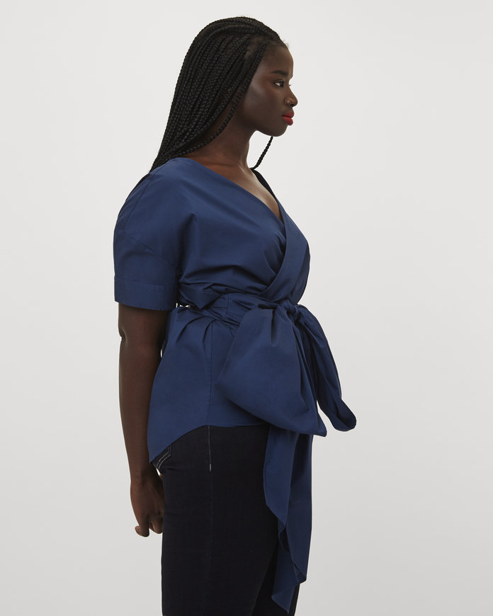 Universal Standard blue wrap top