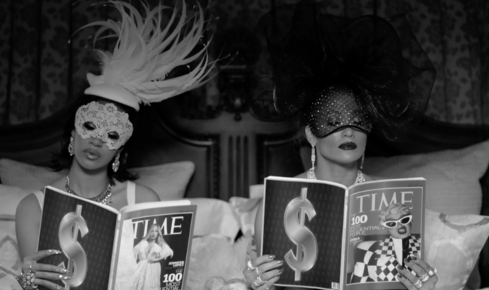 <p>J.Lo and Cardi B. lounge in masquerade wear and piles of diamonds while reading each other's respective <em>Time</em> Magazine cover stories</p>