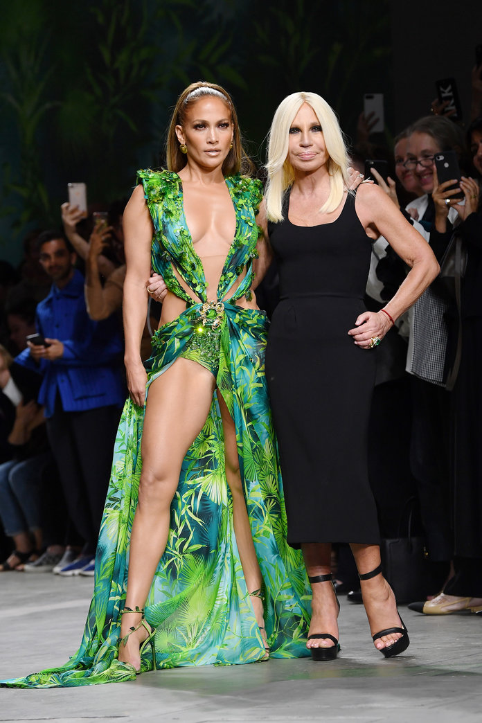 Jennifer Lopez wearing a green dress on the Versace runway