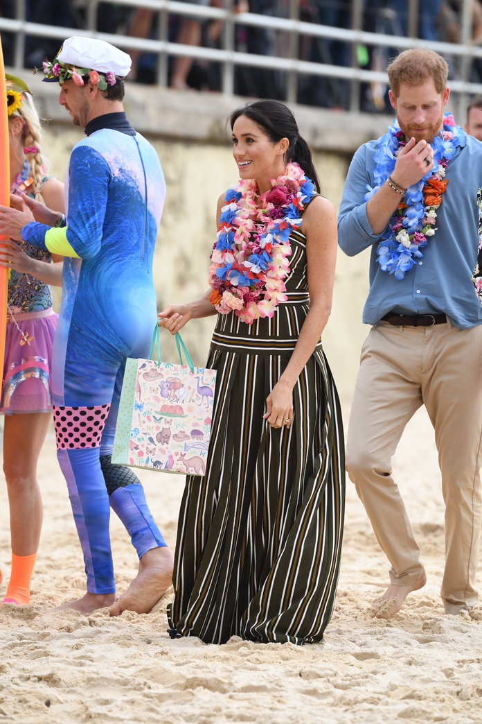 Megan Markle wearing a striped dress at Bondi Beach