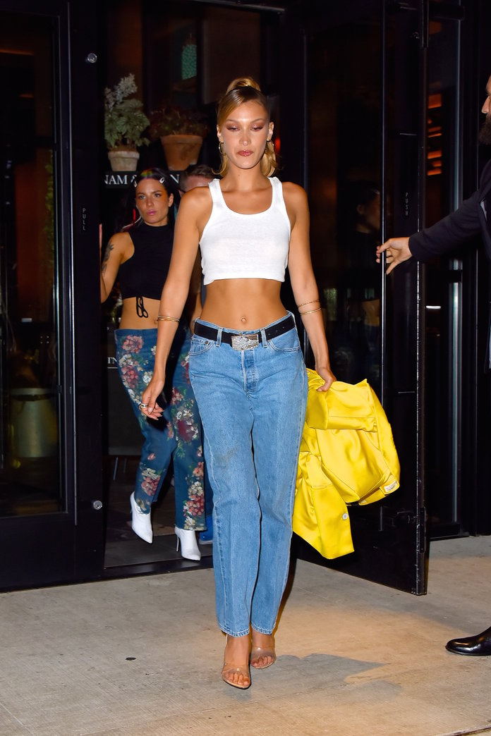 Bella Hadid belting her jeans