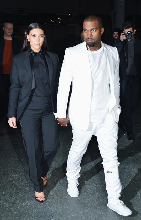 Kim Kardashian and Kanye West attend the Givenchy  Fall/Winter 2013 Ready-to-Wear show