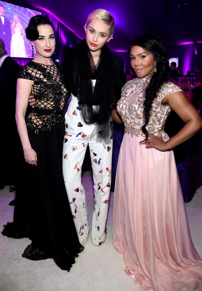 Dita Von Teese, Miley Cyrus, and Lil' Kim