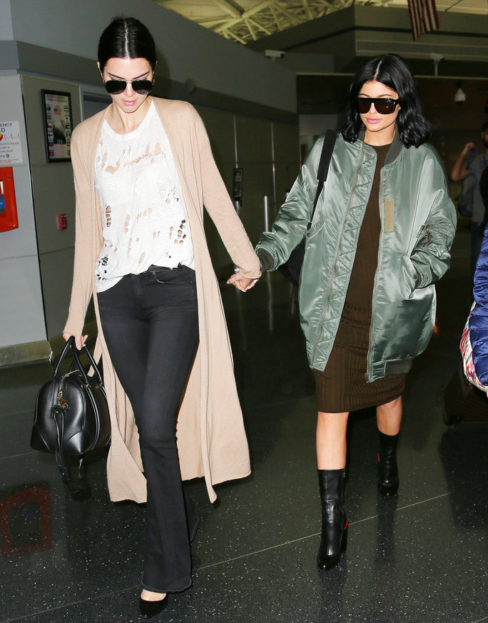 Kylie Jenner and Kendall Jenner hold hands in solidarity when they touch down for the first time in New York City after news broke that Lamar Odom got discharged from the hospital.<P>Pictured: Kylie Jenner and Kendall JennerPicture by: Jackson Lee/Splash