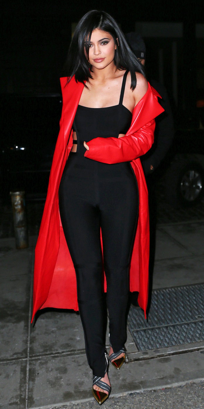 Kylie Jenner channels her inner vampire when out and about in a black form-fitting bodysuit and blood-red jacket in NYC