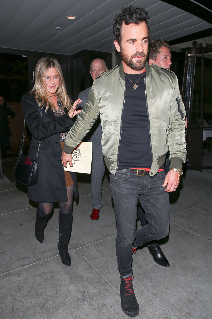 Jennifer Aniston and husband Justin Theroux enjoy a romantic date night out at The Palm restaurant in Beverly Hills. Jennifer has a huge smile on her face as she leaves with her man. Justin reaches back for her, and they hold hands as they head to the car