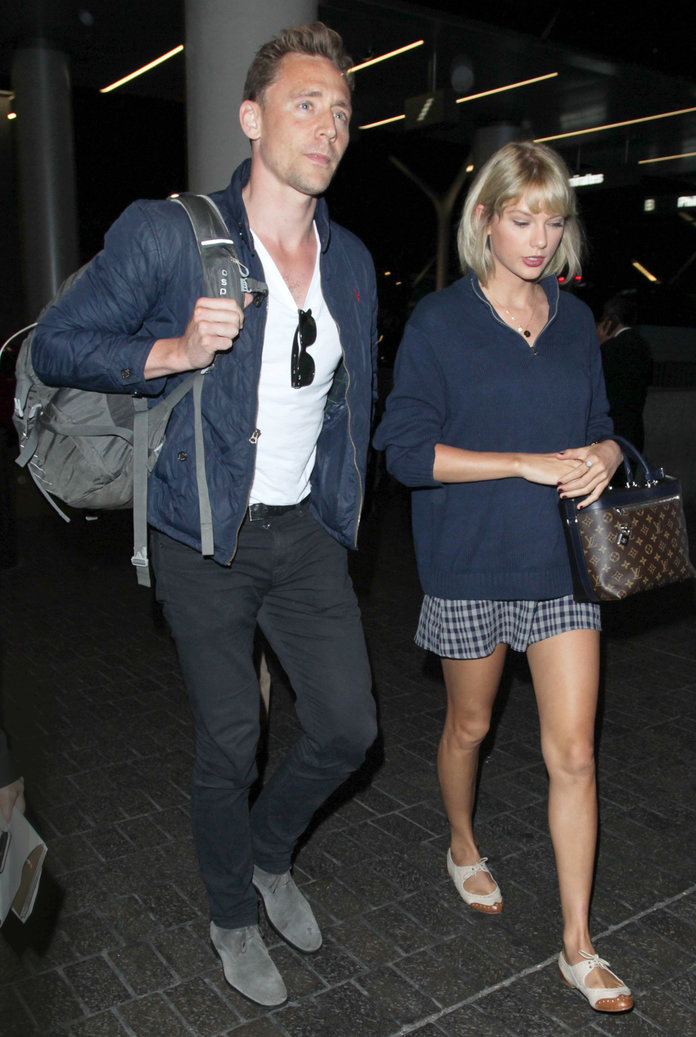 Taylor Swift and Tom Hiddleston Show Off Their Color-Coordinating Travel Style in Navy Looks