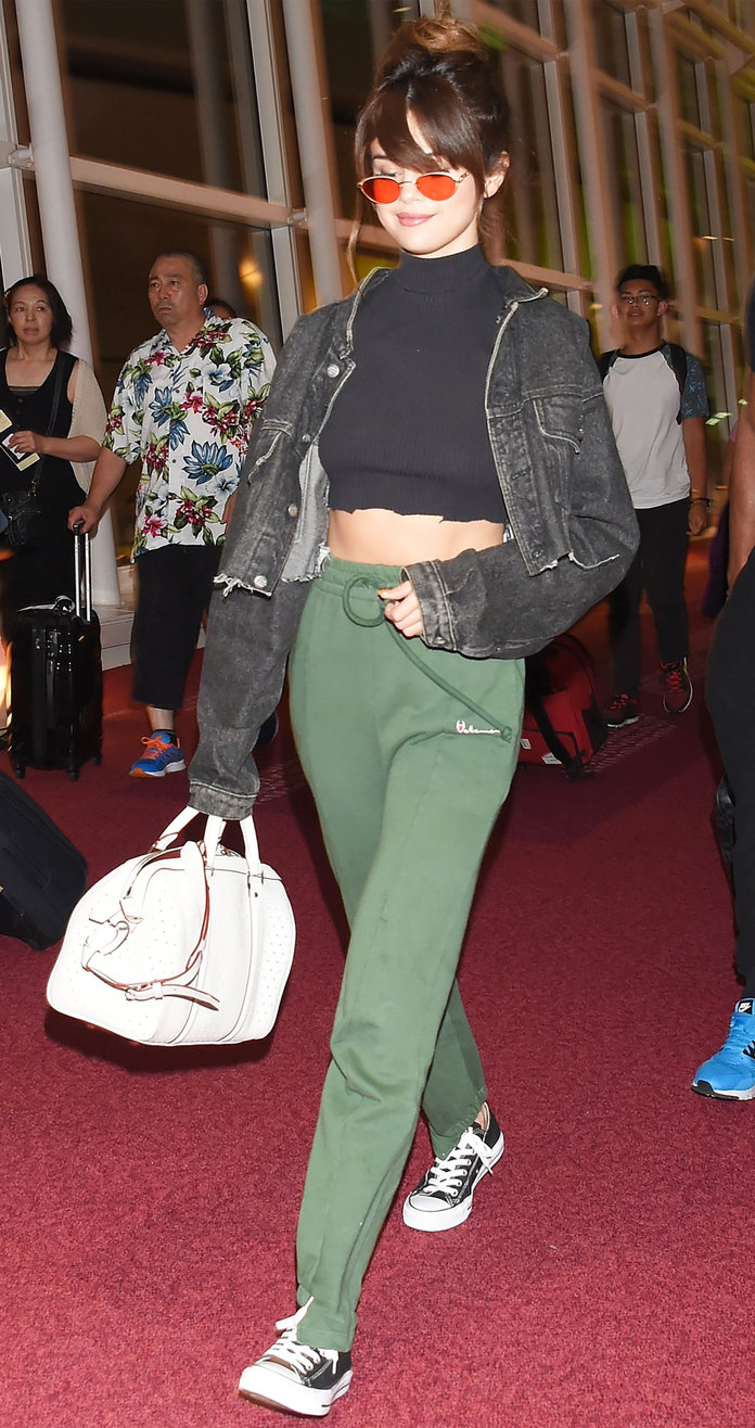 Selena Gomez Touches Down in Tokyo Wearing a Crop Top and Too-Cool Sweatpants