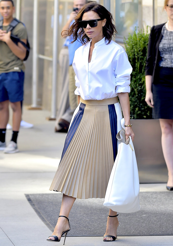 Victoria Beckham S Wears White Shirt And Pleated Skirt In