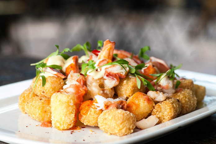 <p>lobster tater tots refinery hotel</p>