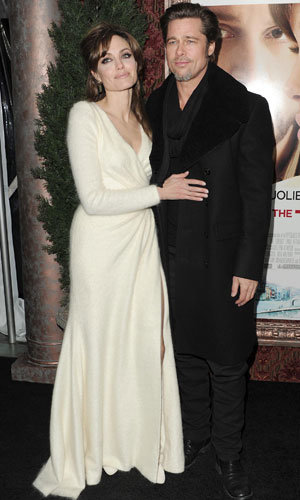 Angelina Jolie wows in white alongside a dapper Brad Pitt at The Tourist premiere