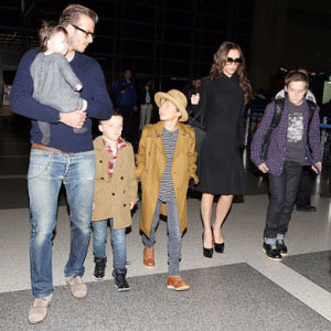 SEE PIC: The Beckhams fly home for Christmas!