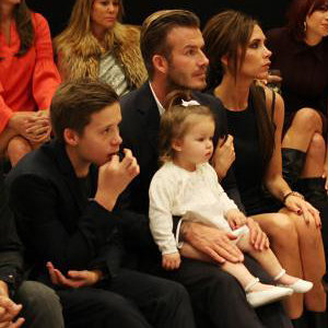 Victoria Beckham takes David and Harper front row