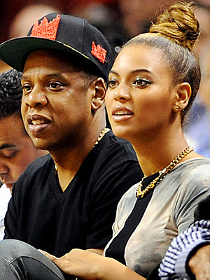 Beyonce works a sleek topknot hairstyle for basketball date